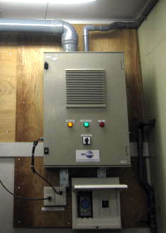 An Indoor model ECB-2 wall-mounted ozone generator installed in a service room of a large supermarket to discourage mice from entering.