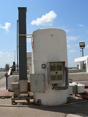 Treatment of odors from waste water plant using two EC-4 wall mounted air fed industrial generators installed on a mixing and contact chamber.